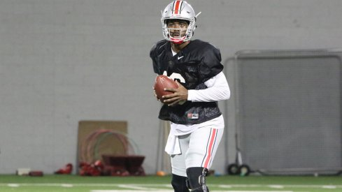 "J.T. Barrett says the progress in Ohio State's passing game is going ""really well"" this summer."