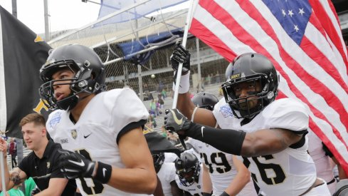 Dec 27, 2016; Dallas, TX, USA; Army Black Knights running back Christian Drake (8) and Black Knights running back Donovan Franklin lead the Army Black Knights onto the field against North Texas Mean Green in the Heart of Dallas Bowl at Cotton Bowl Stadium. Mandatory Credit: Sean Pokorny-USA TODAY Sports