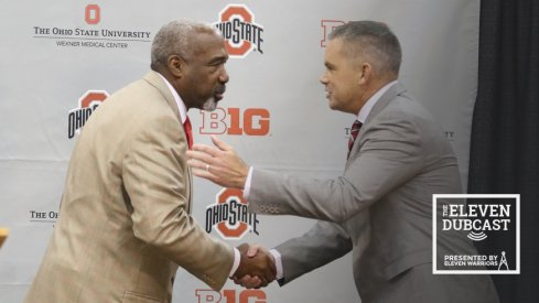 Ohio State athletic director Gene Smith shakes hands with men's basketball head coach Chris Holtmann