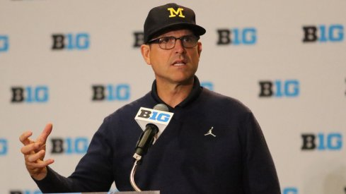 Michigan head coach Jim Harbaugh speaks at Big Ten Media Days.