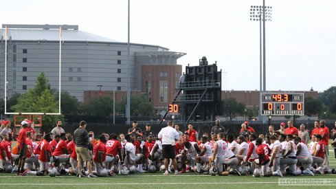 Urban Meyer addresses his team on the first day of fall camp.