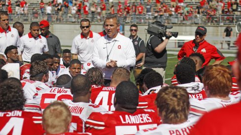 Urban Meyer talks to his team after the 2017 Ohio State spring football game.