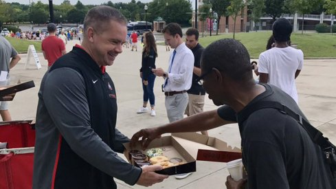 Ohio State head coach Chris Holtmann handing out donuts to freshman and their families