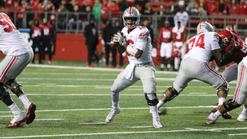 J.T. Barrett became Ohio State's career passing leader as the Buckeyes routed Rutgers.