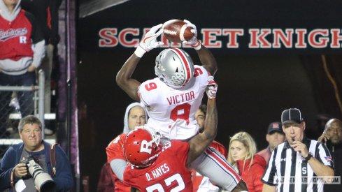 Binjimen Victor Moss'd this Rutgers defender for a touchdown.