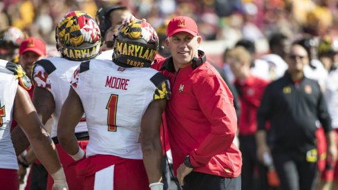 Sep 30, 2017; Minneapolis, MN, USA; Maryland Terrapins head coach DJ Durkin celebrates with wide receiver D.J. Moore (1) after a touchdown in the first half against the Minnesota Golden Gophers at TCF Bank Stadium. Mandatory Credit: Jesse Johnson-USA TODAY Sports