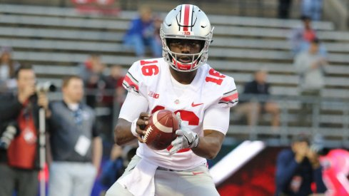 J.T. Barrett warms up against Rutgers