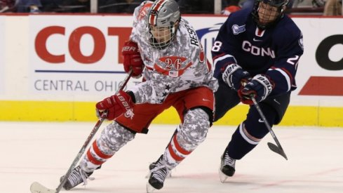 Ohio State's Mason Jobst battles battles a Connecticut Huskies player in a men's hockey game at Value City Arena.