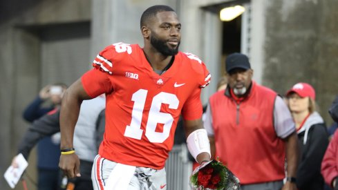 J.T. Barrett takes the field before his final game at Ohio Stadium.