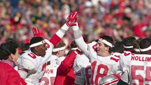 "Ohio State players celebrated after wearing ""Earle"" headbands and beating Michigan in Earle Bruce's final game in 1987. (Robert Kozloff, Associated Press)"