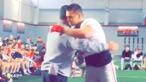 Sam Hubbard hugs Urban Meyer after Senior Tackle.