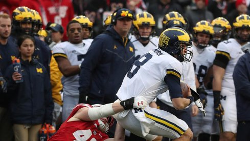 Michigan quarterback John O'Korn.