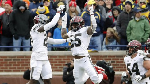 Parris Campbell and Mike Weber celebrate Weber's game-clinching touchdown in Ann Arbor.