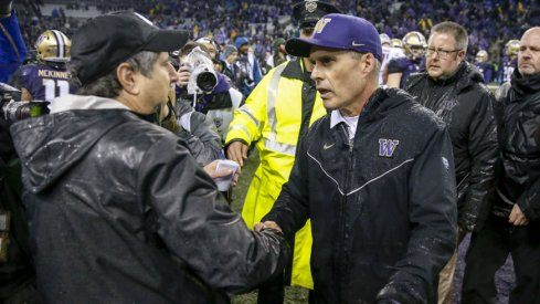 Nov 25, 2017; Seattle, WA, USA; Washington State Cougars head coach Mike Leach (left) shakes hands with Washington Huskies head coach Chris Petersen after their game at Husky Stadium. Mandatory Credit: Jennifer Buchanan-USA TODAY Sports