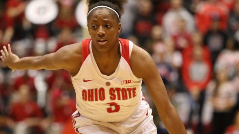 Kelsey Mitchell breaks all-time scoring record.
