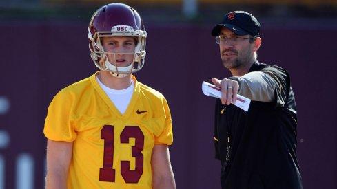 Former USC quarterbacks coach Tyson Helton coaches Trojans backup quarterback Jack Sears prior to the season.