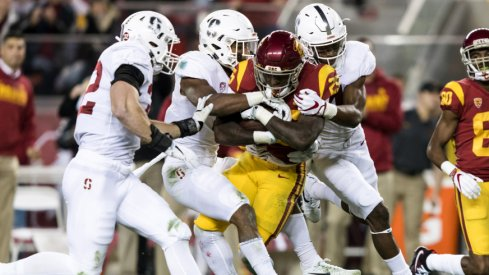 Dec 1, 2017; Santa Clara, CA, USA; USC Trojans running back Ronald Jones II (25) is tackled by the Stanford Cardinal in the second quarter of the Pac-12 Conference championship game at Levi's Stadium. Mandatory Credit: John Hefti-USA TODAY Sports