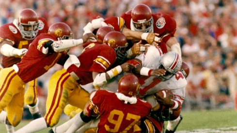 Keith Byars gang-tackled by USC in the 1985 Rose Bowl. (Inside USC)