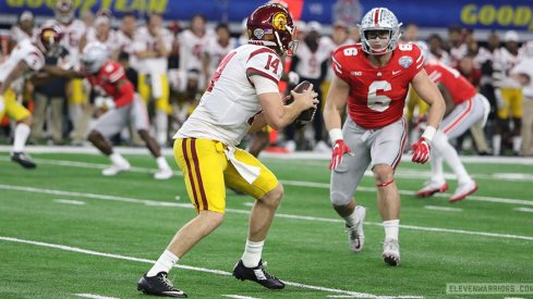 Sam Hubbard encroaches on Sam Darnold.