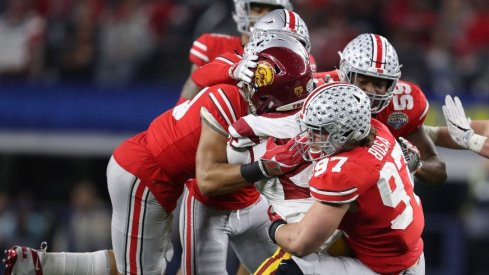 The Ohio State defense wraps up USC running back Ronald Jones in the 2017 Cotton Bowl.