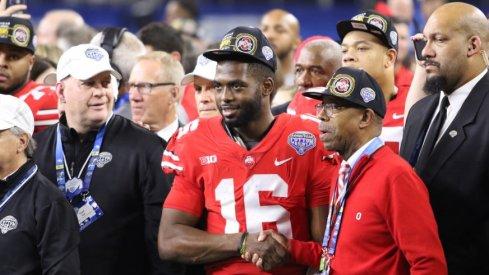 Ohio State quarterback J.T. Barrett and Ohio State president Michael Drake