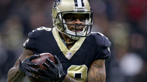 Ted Ginn sprints past defenders.