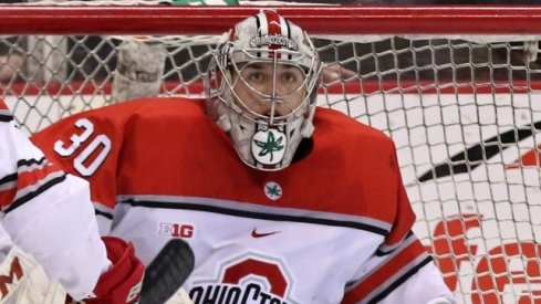 Buckeye goalie Sean Romeo locks in on the puck in a game against the Michigan Wolverines.