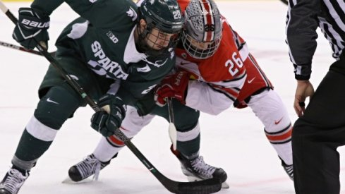 Buckeye captain Mason Jobst and Ohio State men's hockey square off against the Michigan State Spartans.