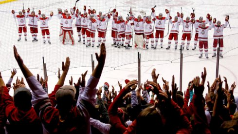 Ohio State men's hockey celebrates a win with the Buckeye students.