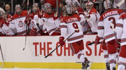Tanner Laczynski celebrates a goal with his Buckeye teammates.