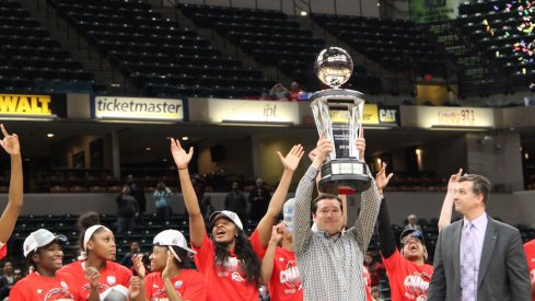 Kevin McGuff and the Ohio State women's basketball team celebrate their Big Ten Tournament championship.