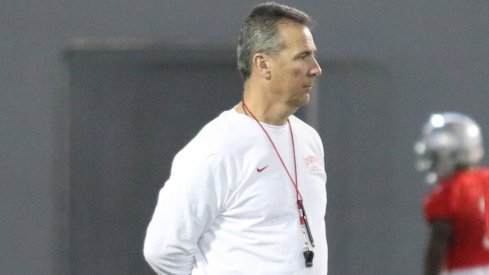 Urban Meyer watches closely during the first spring practice of the year.