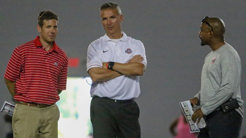 Director of player development Mark Pantoni, head coach Urban Meyer and assistant director of player personnel Eron Hodges