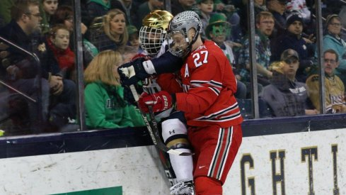 Buckeye forward Luke Stork plasters the glass with an Irish skater.