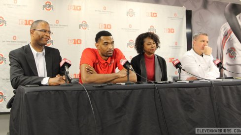 Keita Bates-Diop, flanked by his parents Richard and Wilma, and Chris Holtmann