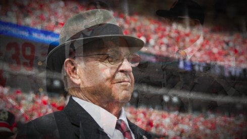 "Oct 1, 2016; Columbus, OH, USA; Former Ohio State Buckeyes head coach Earle Bruce awaits on the sidelines for his chance to dot the ""I"" during the marching band's Script Ohio performance before the game against the Rutgers Scarlet Knights at Ohio Stadium. Ohio State won the game 58-0. Mandatory Credit: Greg Bartram-USA TODAY Sports"