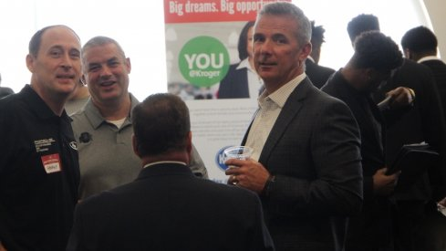 Urban Meyer chats with director of football operations Brian Voltolini and car dealer George Kauffman at the Ohio State Job Fair.