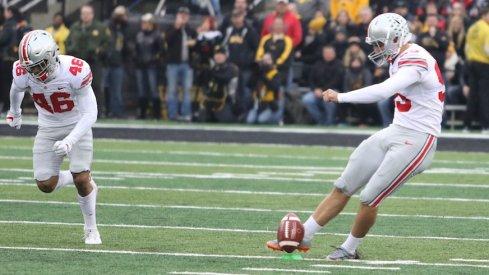 Blake Haubeil kicking off during Ohio State's 2017 game at Iowa.