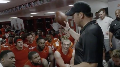 Ohio State coach Ryan Day receives the game ball following his team's 77-31 win over Oregon State