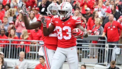 Parris Campbell and Terry McLaurin celebrate in the end zone.
