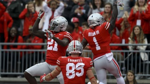 Parris Campbell celebrates one of his two touchdowns with Johnnie Dixon and Luke Farrell.
