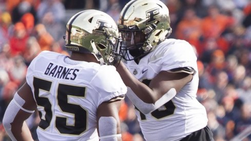 Oct 13, 2018; Champaign, IL, USA; Purdue Boilermakers linebackers Derrick Barnes (55) and Cornel Jones (46) celebrate after sacking Illinois Fighting Illini quarterback AJ Bush Jr. (1) during the second quarter at Memorial Stadium. Mandatory Credit: Mike Granse-USA TODAY Sports