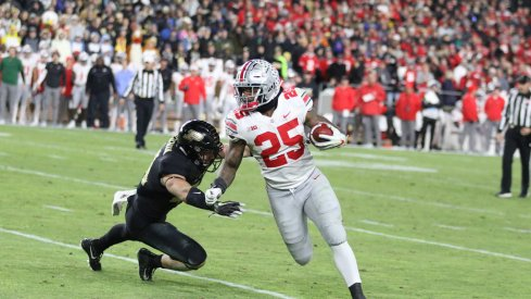 Mike Weber escapes an attempted tackle from Purdue's Thieneman