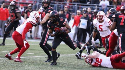 J.K. Dobbins squares up against an Nebraska defender.