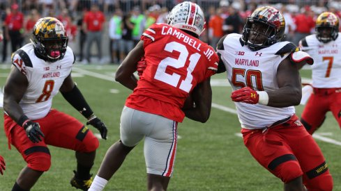 Parris Campbell attempts to break free of some nasty Terrapins.