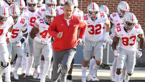 Urban Meyer running away from your tweets