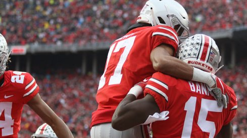 Chris Olave and Sevyn Banks celebrate teaming up for a blocked punt for a touchdown in the win over Michigan.