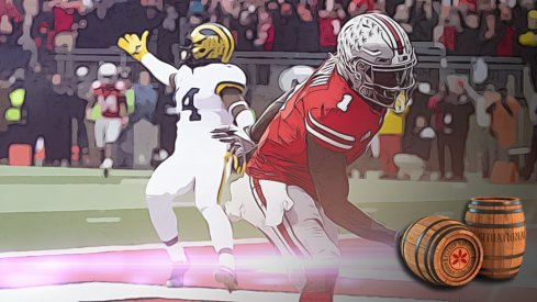 Nov 24, 2018; Columbus, OH, USA; Ohio State Buckeyes wide receiver Johnnie Dixon (1) scores a touchdown as Michigan Wolverines defensive back Josh Metellus (14) gestures to the officials at Ohio Stadium. Mandatory Credit: Greg Bartram-USA TODAY Sports