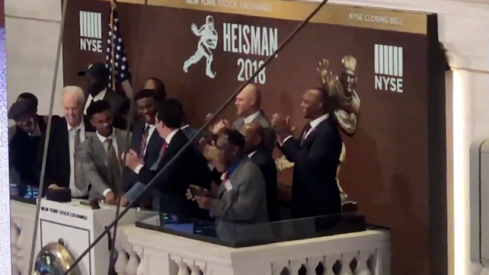 Dwayne Haskins helps ring the bell at the New York stock exchange.