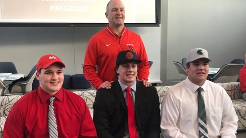Ryan Jacoby, Noah Potter and Nick Samac joined by Mentor head coach Steve Trivisonno